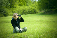 Girl with binoculars royalty free stock image