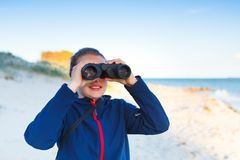 Girl with binoculars royalty free stock images