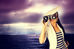 Girl with binoculars. Stock Photo