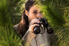Girl with binoculars Stock Images