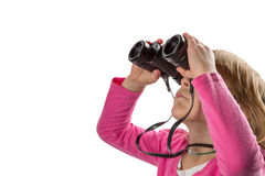 Girl with Binoculars Looking Up at Copy Space. Young girl with binoculars looking up at copy space. Isolated on white background royalty free stock images