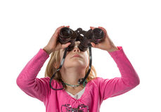 Girl with Binoculars Looking Up. Young girl with binoculars looking up. Isolated on white background royalty free stock photos