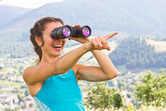 Girl binoculars Royalty Free Stock Images