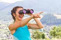 Girl binoculars Royalty Free Stock Images