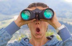 Girl binoculars Stock Images