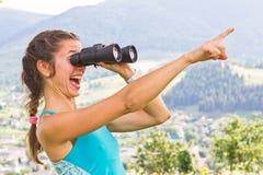Girl binoculars Stock Photos