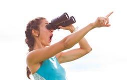 Girl binoculars Stock Image