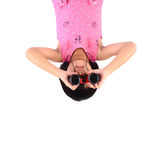 Girl with binoculars vertical. Stock Photo