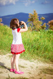 Girl with binoculars Royalty Free Stock Photos