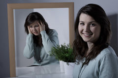 Girl and bipolar disorder. Smiling pretty young girl with bipolar disorder Royalty Free Stock Photo