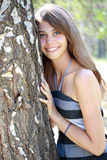 Girl and birch. Portrait of young attractive girl embracing birch tree at summer green park Stock Image