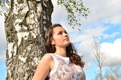 Girl of about birch Royalty Free Stock Photo