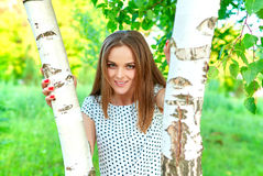 Girl at a birch Stock Photography