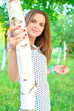 Girl at a birch Stock Image