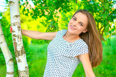 Girl at a birch Stock Photos