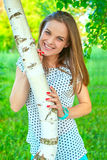 Girl at a birch Stock Images