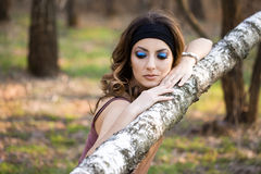 Girl in a birchwood Royalty Free Stock Photography