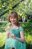 Girl with bird cherry branch Stock Photography