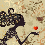 Girl and a bird with a valentine Stock Images