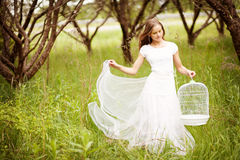Girl with birdcage Royalty Free Stock Images