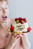 Girl with a birthday cake Stock Photos