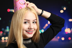Girl with a birthday cap Royalty Free Stock Photo