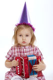 Girl with birthday cap playing accordion stock images