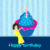 Girl with birthday cupcake Stock Photography