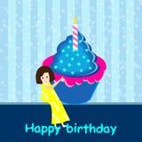 Girl with birthday cupcake Stock Photography