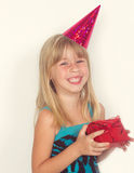 Girl with a birthday gift and cap Stock Images