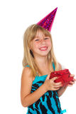 Girl with a birthday gift and cap Royalty Free Stock Images