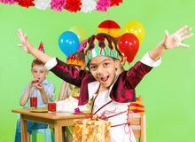 Girl at the birthday party Stock Photography