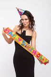 Girl on the birthday party. Pretty girl holding a happy birthday tape Royalty Free Stock Images