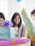 Girl With Birthday Presents In Foreground Stock Photo