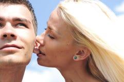 Girl bite. On boyfriend ear royalty free stock images