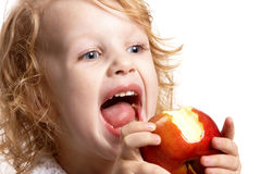 Girl bites an apple Royalty Free Stock Photos