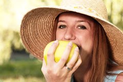 Girl bites apple Royalty Free Stock Photo