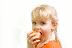 Girl bites apricot Stock Photos