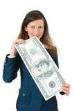 Girl bites the big bucks. On a white background Royalty Free Stock Photos