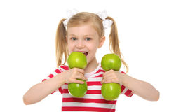 Girl bites dumbbell from apples Stock Image