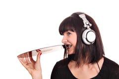 Girl bites lp record Stock Photo