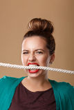 Girl bites the rope. Royalty Free Stock Photos