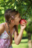 Girl biting into an apple Stock Photo