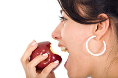 Girl biting an apple Royalty Free Stock Image