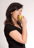 Girl biting an apple Stock Photo