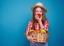 Girl biting apple Stock Image