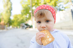 Girl Biting Biscuit Royalty Free Stock Images
