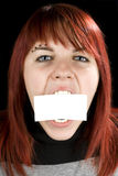 Girl biting a blank greeting card Stock Photos