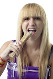 Girl Biting a Bone Royalty Free Stock Photos