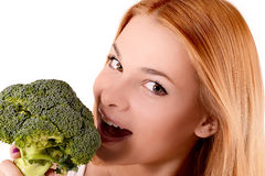 Girl biting a cabbage. Girl biting a green cabbage stock photo